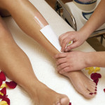Depilation with wax in beauty salon